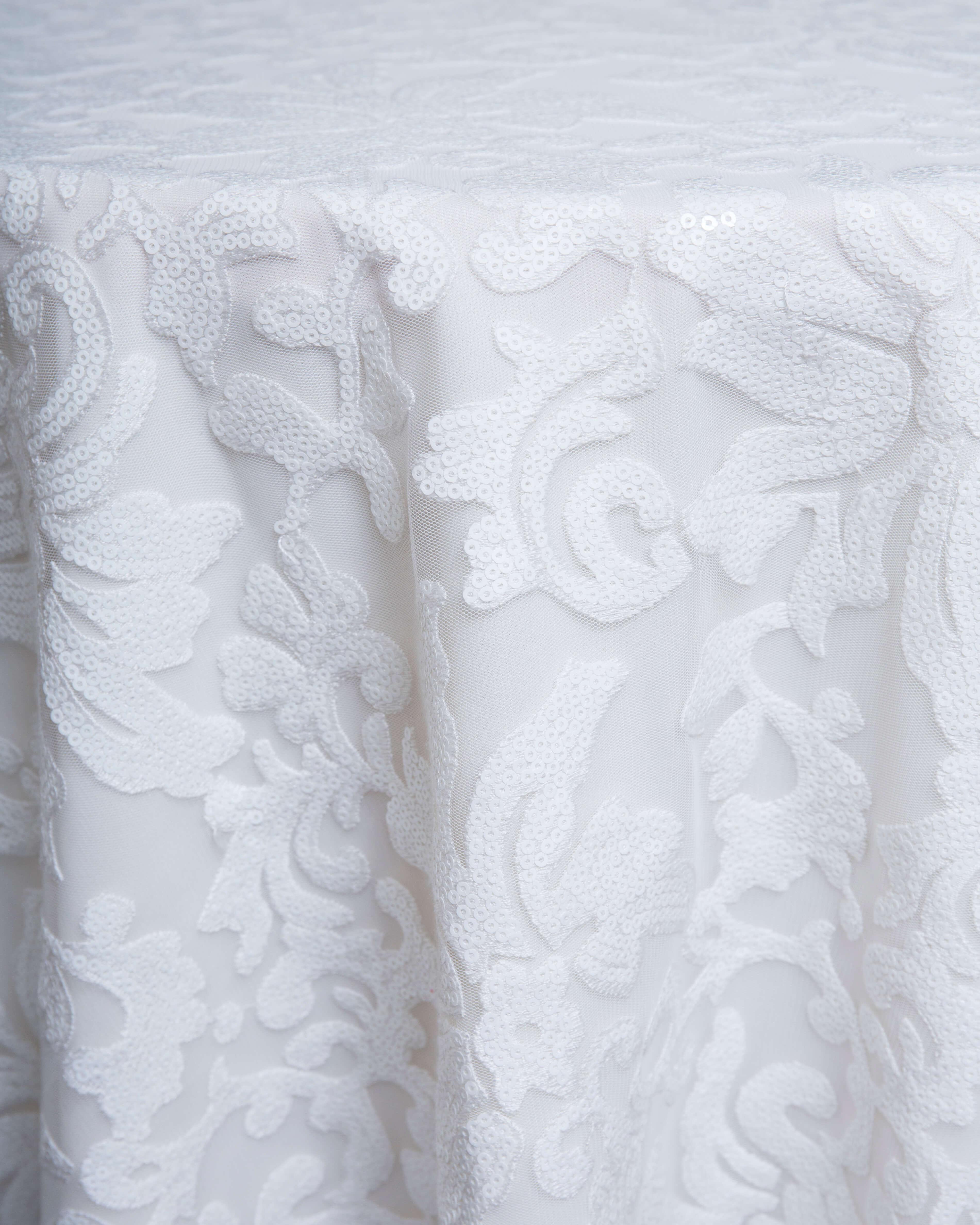 white overlay linen rental
